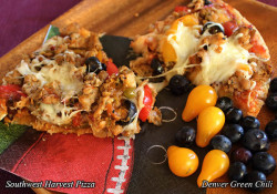 Southwest Harvest Pizza is a loaded pizza with lots of peppers - bell peppers and green chiles - and Italian sausage, a real favorite, plus pizza and Mexican cheeses. Yum!